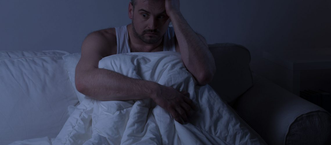 39459879 - mature man with insomnia sitting in the bed