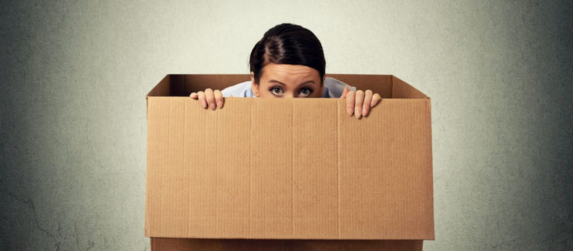 43705172 - young woman hiding in a carton box